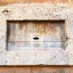 Alms box on the left of the entrance to the complex of San Giovanni Decollato, Rome