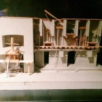 The scale model of a mural section with the reconstruction of the goods-hoists system.