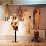 "Terracotta statues representing the devotees to Minerva, from the votive store related to the Minerva sanctuary, dating between 5th-3rd century BC, first room of Tritonia Virgo, Museo Civico Archeologico ""Lavinium"", Pomezia (RM)"