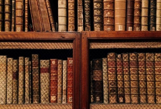 Old books on the wooden shelves at the Biblioteca Angelica, Rome