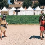 ncient Roman gladiatorial salute, featuring at the historical camp set in April 20-22, 2018 at Circus Maximus, during the celebrations of the founding of Rome, in Italy called Natale di Roma
