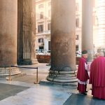 The officiating clergymen waiting outside the monument, on the occasion of the Pentecost ceremony at the Pantheon in Rome