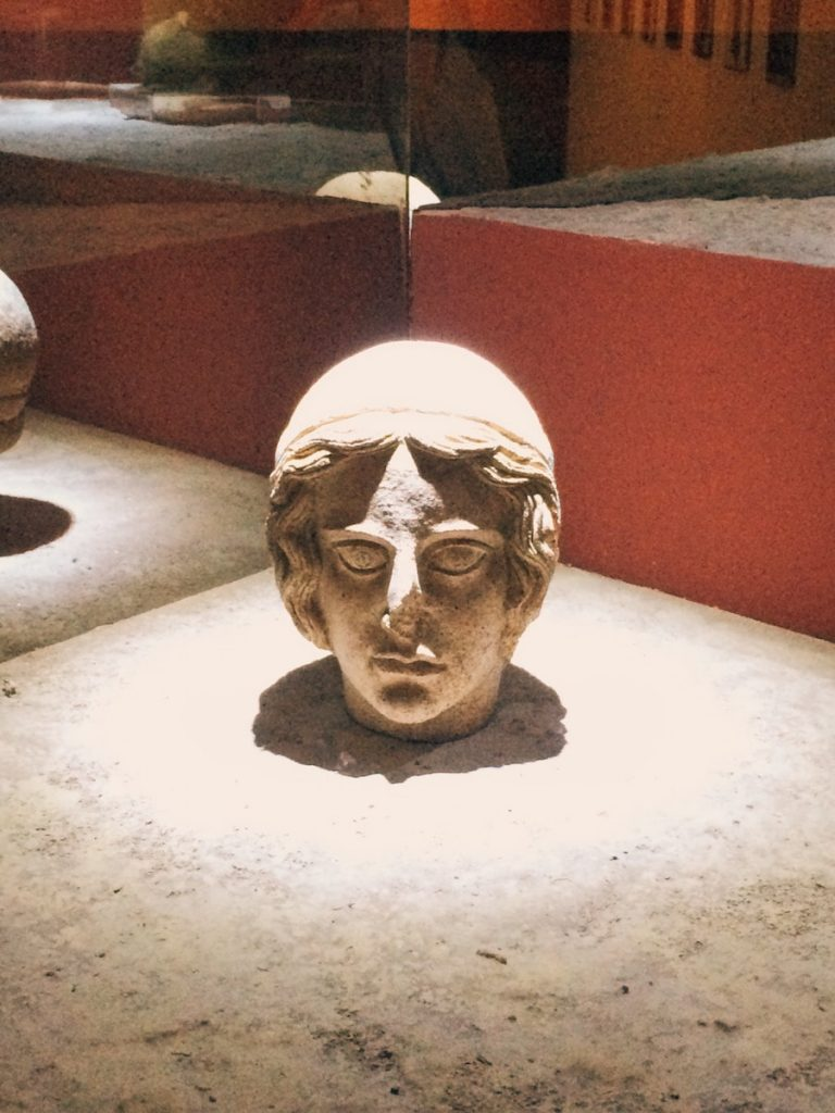 "Votive terracotta head coming from the store of Minerva sanctuary at Lavinium, second room of Mundus muliebris, Museo Civico Archeologico ""Lavinium"", Pomezia (RM)"