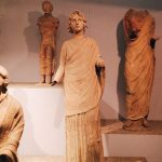"Terracotta female statue wearing tunic and mantle, from the votive store related to the Minerva sanctuary, dating to the 3rd century BC, first room of Tritonia Virgo, Museo Civico Archeologico ""Lavinium"", Pomezia (RM)"