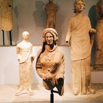 "Terracotta female statue with dove, from the votive store related to the Minerva sanctuary, dating to the mid-5th century BC, first room of Tritonia Virgo, Museo Civico Archeologico ""Lavinium"", Pomezia (RM)"