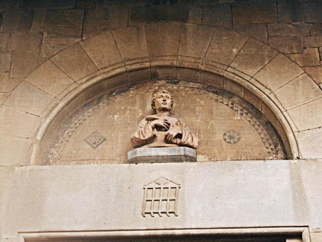 Exterior lunette with a copy of San Lorenzo bust by Donatello, Pieve di San Lorenzo, Borgo San Lorenzo (Mugello), Italy