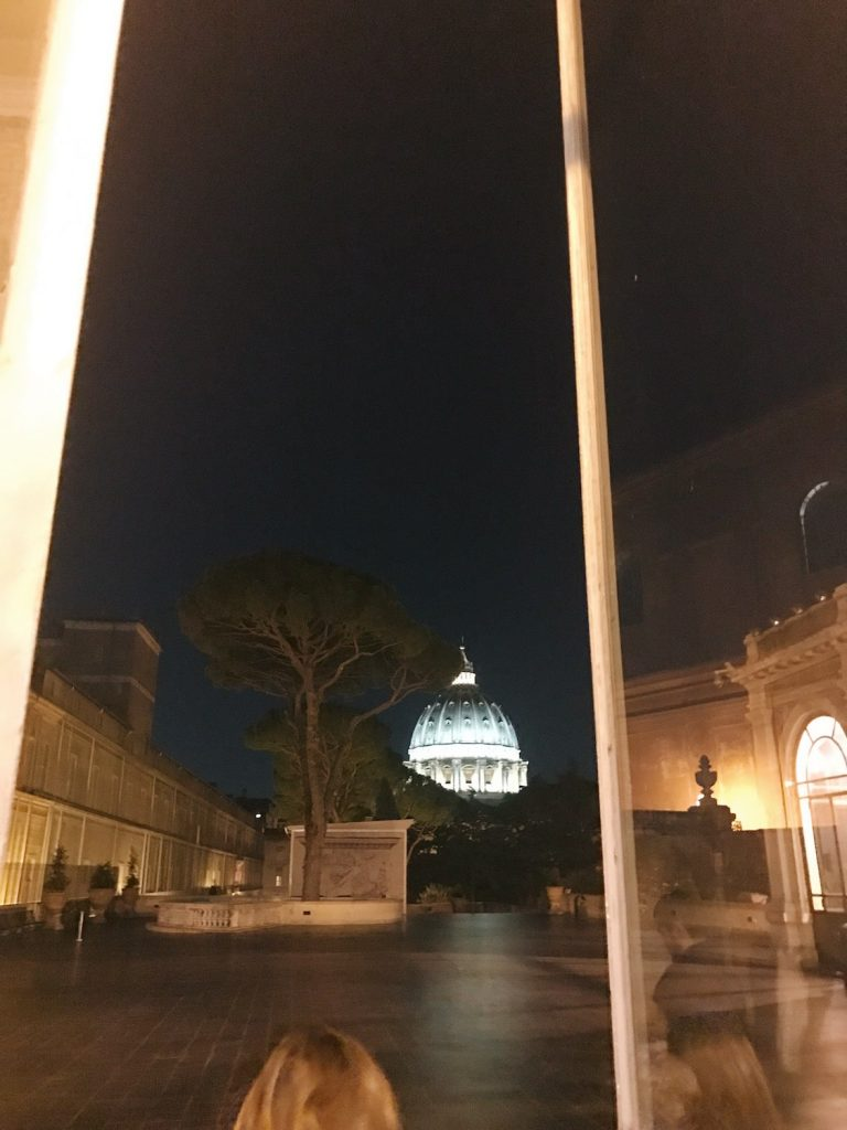 View of St. Peter's dome in the evening from the Vatican Museums