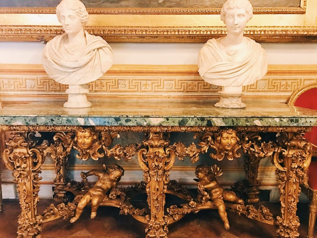 "Carved and gilded wood tables commissioned by Fabrizio Spada in 1699 and Roman busts made of marble, II-II century A.D., Room III, also called ""Galleria del Cardinale"" (Cardinal's gallery), Rome, Palazzo Spada, Galleria"