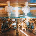 """Carved and gilded wood tables commissioned by Fabrizio Spada in 1699 and Roman busts made of marble, II-II century A.D., Room III, also called """"Galleria del Cardinale"""" (Cardinal's gallery), Rome, Palazzo Spada, Galleria"""